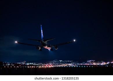 OSAKA, JAPAN - JAN. 3, 2019: ANA Boeing 767-300ER landing to the Itami International Airport in Osaka, Japan in the night.