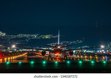 OSAKA, JAPAN - JAN. 4, 2019: ANA Boeing airplane taking off from the Itami International Airport in Osaka, Japan in the night.