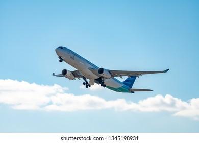 OSAKA, JAPAN - JAN. 4, 2019: Garuda Indonesia Airbus A330-300 taking off from the Kansai International Airport in Osaka, Japan.