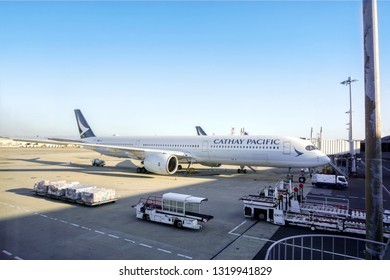 OSAKA, JAPAN, January 13, 2019 : Airplane of CATHAY PACIFIC arriving and parked at Kansai International Airport, Japan with loading baggage and travelers from the plane to the terminal.