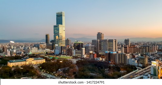 Osaka, Japan, January 18 2019 : Panorama and landscape view of Osaka city on evening and sunset sky background.