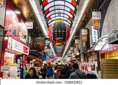 OSAKA , JAPAN - January 31, 2019 : Minami Namba and Shinsaibashi . Tourists and many fresh seafood shop , sushi and sashimi restaurant at daytime .