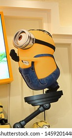 OSAKA, JAPAN - Jul 19, 2019 : Close up of HAPPY MINION statue, located in Universal Studios Japan. Minions are famous character from Despicable Me animation.