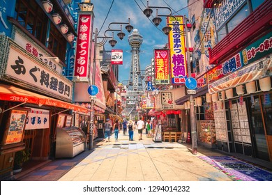 Osaka, Japan - July 22, 2018: Tsutenkaku tower is a famous landmark of Osaka, Japan and advertises Hitachi in Shinsekai district (New world) of Naniwa ward, Osaka, Japan.
