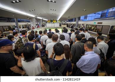 Osaka, Japan - July 24 2015: Crowd of men exits the platform at JR Osaka Station