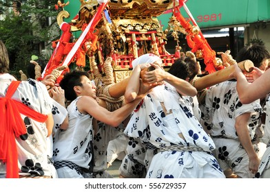 Osaka, Japan - July 25, 2012: Golden portable shrine carried and worshipped by participants of the Tenjin Matsuri Festival, the greatest festival in Osaka boasting of a history of a thousand years.