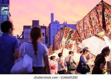 Osaka, Japan - July 25 2018: Sunsets over brightly lit food stalls at Tenjin Festival during summer heatwave