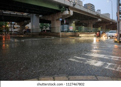 Osaka, Japan - July 5, 2018: Flooded crosswalk at intersection in Suita during heavy rains