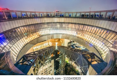 OSAKA, JAPAN - JUN 29, 2018: Floating Garden Observatory of Umeda Sky Building at night. It is a famous landmark in Kita district area.