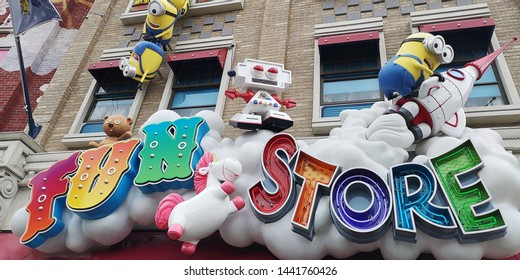"""Osaka, Japan- June 08, 2019: Experience the Minions in action at the Minion Toy Research and Development Headquarters. The billboard of mayhem-filled """"Fun Store"""" in Minion Park at Universal Studios."""