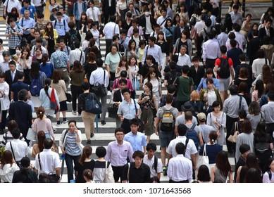 OSAKA, JAPAN- JUNE 21 2017: People cross the street in front of Osaka train station in Osaka, Japan.
