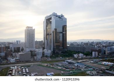 Osaka, Japan - June 22, 2018: Sunset behind Umeda Sky Building in the city center
