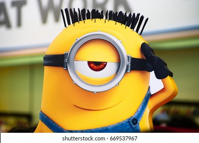 """OSAKA, JAPAN - June 24, 2017 : Statue of """"HAPPY MINION"""", located in Universal Studios Japan, Osaka, Japan. Minions are famous character from Despicable Me animation."""