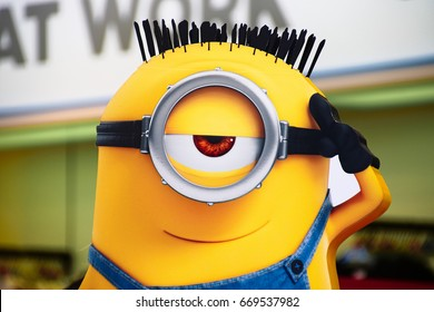"OSAKA, JAPAN - June 24, 2017 : Statue of ""HAPPY MINION"", located in Universal Studios Japan, Osaka, Japan. Minions are famous character from Despicable Me animation_A"