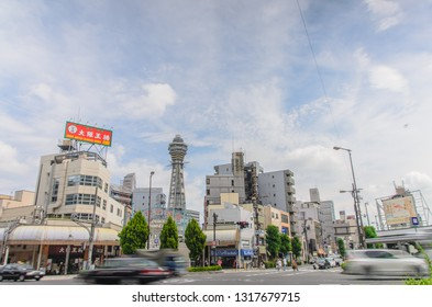 OSAKA , JAPAN - June 29 2018 :Tsutenkaku Tower. Tsutenkaku is a symbol of a new world in Osaka which was built in 1912. Tourists come enjoy restaurants and bars in this area .