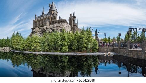 OSAKA, JAPAN - June 5, 2017: Universal Studios Japan (USJ). The Hogwarts castle reflect to the water in The Wizarding World of Harry Potter in Universal Studio Osaka