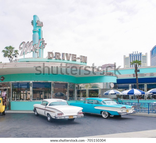 Osaka, Japan -  June2, 2015 : A photo of Mel's Drive in cafe and restaurant with vintage cars parking located in front at at Universal Studios Japan, a theme park in Osaka. Editorial use only.