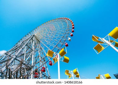 OSAKA, JAPAN -MAR 26, 2019: Tempozan Giant Ferris Whell against clear blue sky. Tempozan Ferris Wheel has a diameter of 100 meters, making it one of the world's largest Ferris wheel.