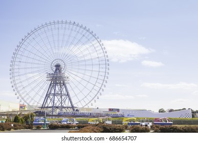 OSAKA, JAPAN - March 24, 2017: Redhorse Osaka Wheel, EXPOCITY, and Osaka Monorail viewed from Expo '70 Commemoration Park