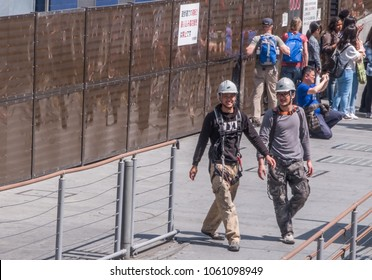 OSAKA, JAPAN - MARCH 28TH, 2018. Construction workers walking in the street of Dotonburi, Osaka.