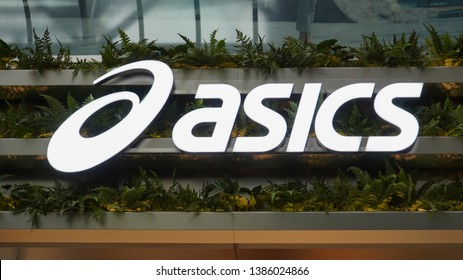 Osaka, Japan - March 29, 2019 :  Asics logo in front of store in Japan. Asics is a Japanese multinational company which produces footwear and sports equipment