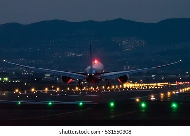 OSAKA, JAPAN - MAY 1, 2016: Boeing 787 landing to the Itami International Airport in Osaka, Japan at dusk.