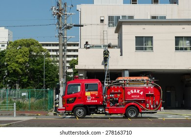 OSAKA, JAPAN - MAY 10, 2015: Training of firefighters in the fire station with ladder.