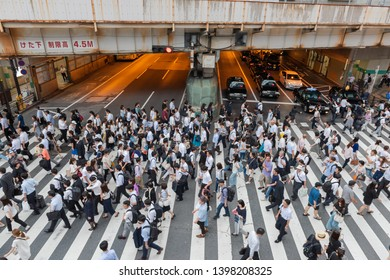 Osaka, Japan, May 15, 2019: Many tourists and pedestrians cross a busy intersection in Osaka, Japan.