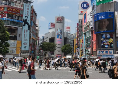 Osaka, Japan, May 15, 2019: Pedestrians cross an intersection in the Shibuya district of Tokyo, Japan.