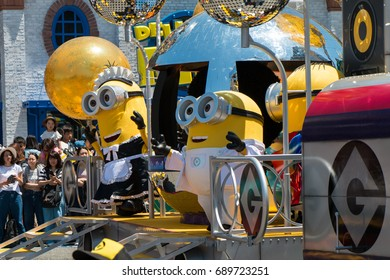 OSAKA JAPAN - MAY 18: Minions parade show in various costume with many people watching in Universal studio theme park in a sunny day on May 18, 2017 in Osaka, Japan