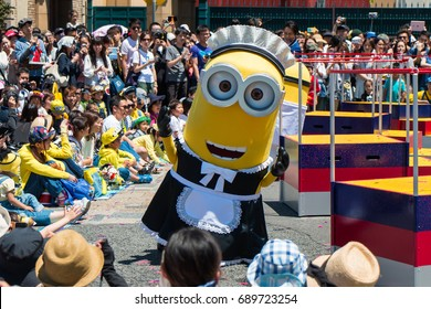 OSAKA JAPAN - MAY 18: Minions parade show in maid cloths with many people watching in Universal studio theme park in a sunny day on May 18, 2017 in Osaka, Japan