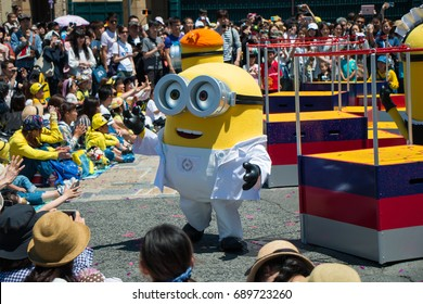 OSAKA JAPAN - MAY 18: Minions parade show in scientist cloths with many people watching in Universal studio theme park in a sunny day on May 18, 2017 in Osaka, Japan