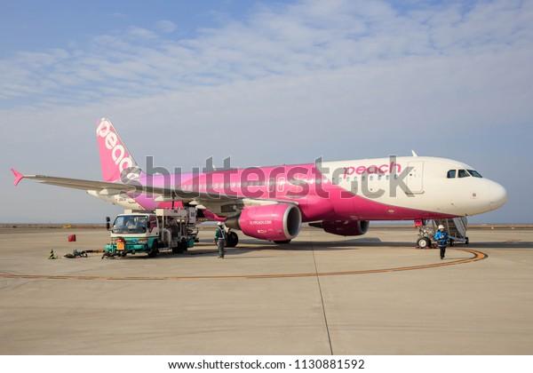 Osaka, Japan - May 2, 2015: Airbus A320 on tarmac at Kansai International airport prepares for passenger boarding