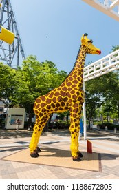 OSAKA, JAPAN - MAY 20, 2016: The giant giraffe that made by Lego blocks at Tempozan Harbor village in Osaka, Japan.