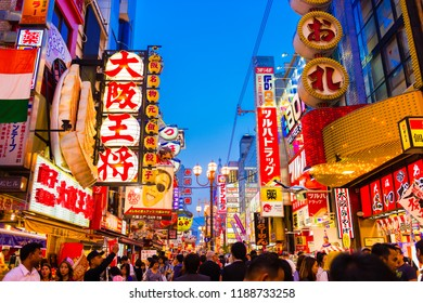 OSAKA, JAPAN - MAY 20, 2016: Many tourists walking in Dotonbori, the famous shopping street in Osaka, Japan.