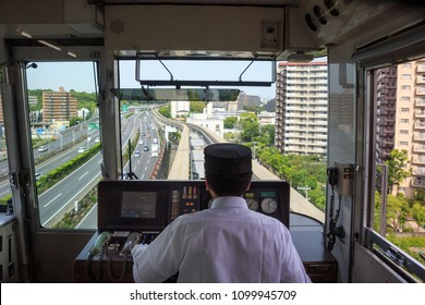Osaka, Japan - May 26, 2018: Operator of the Osaka Monorail accelerates the train out of Yamada Station