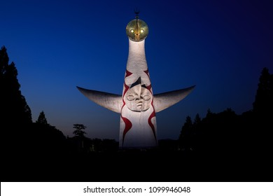 Osaka, Japan - May 26, 2018: The Tower of the Sun illuminated at dusk in Bampaku Memorial Park