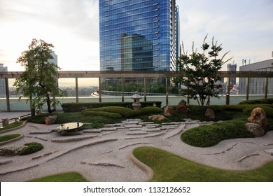 Osaka, Japan - May 29, 2018: Small Japanese rock garden provides a quiet rest spot on roof of JR Osaka Station