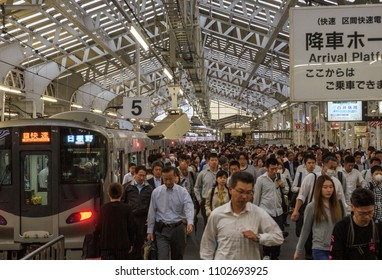Osaka, Japan - May 31, 2018: Passengers stream off the train from Hineno at JR Tennoji Station