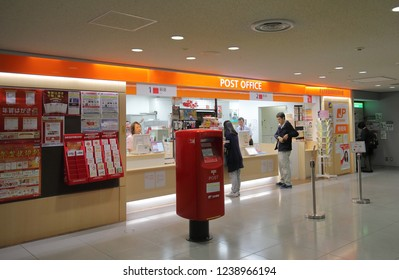 OSAKA JAPAN - NOVEMBER 14, 2018: Unidentified people visit post office at Kansai airport Osaka Japan.