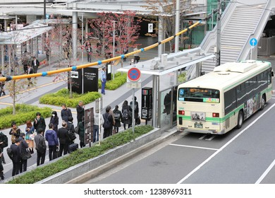 OSAKA JAPAN - NOVEMBER 14, 2018: Unidentified people queue at bus stop at Osaka train station Japan.