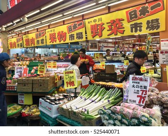 Osaka, Japan - November 19, 2016: Local people are shopping at Kuromon Ichiba market, Nipponbashi, Osaka, Japan