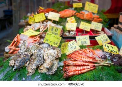 Osaka, Japan - November 19, 2017 :Many fresh seafood at Kuromon Ichiba fish market. The Kuromon Ichiba Market is a large market and most popular in Osaka, Japan