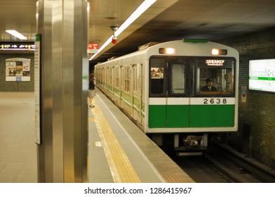 OSAKA, JAPAN - NOVEMBER 2, 2018: Train arriving at railway station in Osaka, Japan