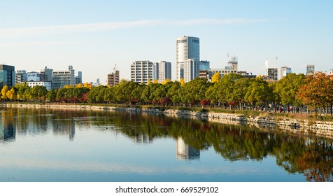 OSAKA, JAPAN - NOVEMBER 22, 2014: Colorful autumn leaves reflecting on the water in front of the Osaka Castle Park.