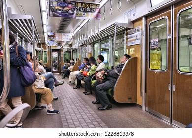 OSAKA, JAPAN - NOVEMBER 22, 2016: People ride a subway train in Osaka Metro, Japan. Osaka Metro has 133 stations and carries more than 2 million passengers daily.