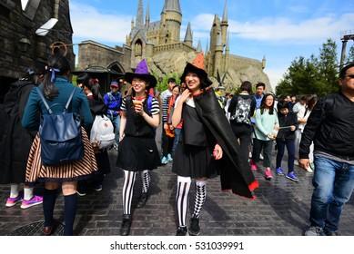 OSAKA, JAPAN - OCTOBER 13, 2016: Untitled Japanese in wizard cosplay at Diagon alley at Wizarding World of Harry Potter at Universal Studios Osaka, Japan.
