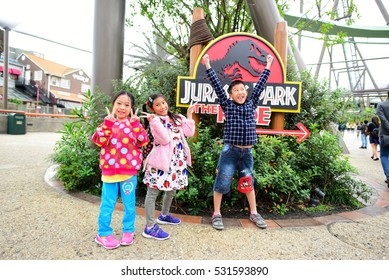 OSAKA, JAPAN - OCTOBER 13, 2016: Happy children at Jurassic Park The Ride at Universal Studios Japan