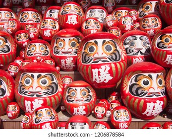 OSAKA, JAPAN - OCTOBER 17 2018: Daruma dolls at Katsuo-ji on October 17, 2018 in Osaka. People left these dolls at the temple ground hoping to obtain luck. Translation of text: Win.