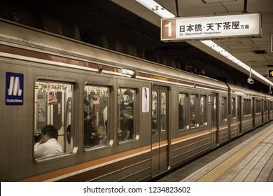 OSAKA, JAPAN - October 18, 2018: An Osaka Subway train bound for Tengachaya in the subway station at Osaka, Japan.